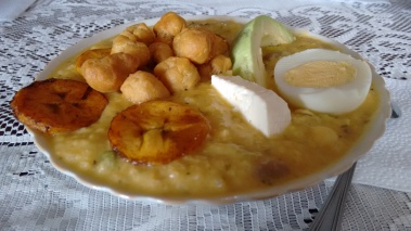 The Fanesca was served with fried plantains, fried dough balls, a slice of avocado, cheese, a hard boiled egg and some salted fish boiled in milk as toppings, finished off with Arroz de Leche for dessert.